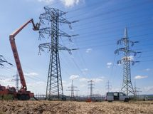 Maintenance of high voltage lines. Maintenance with forklift platform on high voltage lines royalty free stock images
