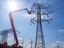 Maintenance of high voltage lines. Maintenance with forklift platform on high voltage lines stock photos