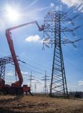 Maintenance of high voltage lines. Maintenance with forklift platform on high voltage lines stock photo
