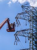 Maintenance of high voltage lines. Maintenance with forklift platform on high voltage lines royalty free stock photos