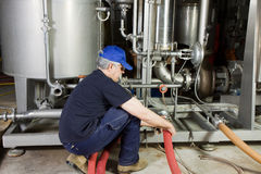Maintenance machinery. Worker at work with some maintenance stock photo