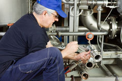 Maintenance machinery. Worker at work with some maintenance stock photos