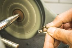 Maintenance of precious diamond ring. In jewellery workshop Stock Images