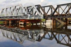 Maintenance of railway bridge, water reflection. Stock Image
