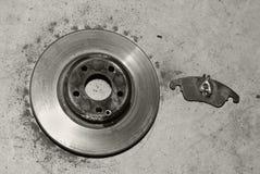 Maintenance and repair of the car. Worn brake discs and pads. Maintenance and repair of the car Stock Photography