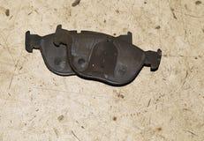 Maintenance and repair of the car. Worn brake pads. Maintenance and repair of the car Royalty Free Stock Images