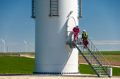 Maintenance repair team windmill turbine Royalty Free Stock Image