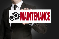 Maintenance only sign is held by businessman Stock Image