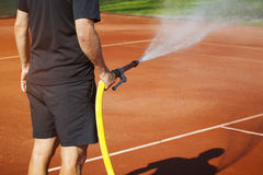 Maintenance sprinkler tennis court Royalty Free Stock Photos