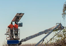 Maintenance of streetlight. Workers. Royalty Free Stock Photo