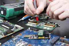 Electronic circuit board inspecting close up Stock Images