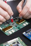 Electronic circuit board inspecting close up Royalty Free Stock Photography