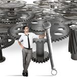 Maintenance of a system of gears Royalty Free Stock Photos
