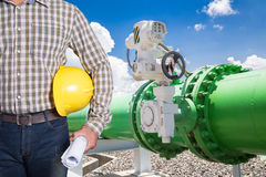 Maintenance technician with pipeline valves of cooling water sys Stock Photo