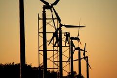 Maintenance wind turbine. Two man maintenance wind turbine silhouette Royalty Free Stock Photo
