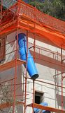 Maintenance work of the building after the earthquake. Blue pipe during maintenance work of the building after the earthquake royalty free stock image