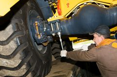 Maintenance work of heavy loader Stock Images