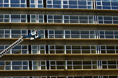 Maintenance worker. In a crane inspecting a new residential building Royalty Free Stock Photography