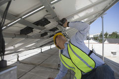 Maintenance Worker Adjusting Solar Panels Stock Images