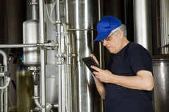 Maintenance. Worker in a liquid plant for general purpose Stock Photography