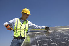 Maintenance Worker Measuring Solar Cells Stock Photos