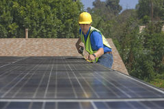 Maintenance Worker Measuring Solar Panels Royalty Free Stock Photography