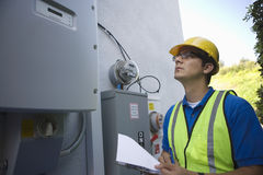 Maintenance Worker Reading Meter Of Solar Generation Stock Images