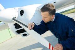 Maintenance works on aircraft stock photos