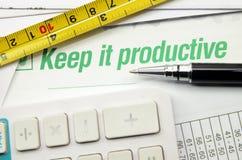Maintenez-le productif imprimé sur un livre images libres de droits