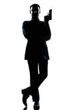 Maintien de James Bond d'agent secret d'homme de silhouette Photo libre de droits