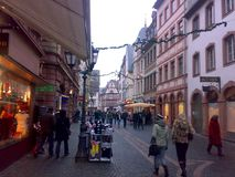 MAINZ, GERMANY - DECEMBER 27, 2007: Architecture and people on the streets city. MAINZ, GERMANY - DECEMBER 27, 2007: Architecture and people on the streets royalty free stock photos