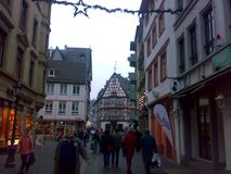 MAINZ, GERMANY - DECEMBER 27, 2007: Architecture and people on the streets city. MAINZ, GERMANY - DECEMBER 27, 2007: Architecture and people on the streets stock photography
