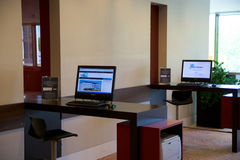MAINZ, GERMANY - JUN 25th, 2017: Business Center with Computer Internet Printer Service, two PC in a luxury Hilton Hotel Stock Images