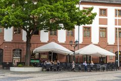 Mainz, Germany - June 12, 2017: People in outdoor restaurant under a big tree royalty free stock image