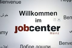 Jobcenter Mainz. Mainz, Germany - June 18, 2018: A wall of the job center Mainz on May 18, 2018 in Mainz, described with a welcome message in different languages Stock Photography