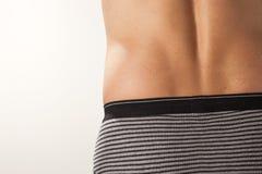 Mais baixa parte traseira masculina Foto de Stock Royalty Free