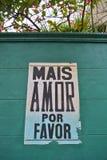 Mais do amor sinal da bandeira por favor Fotografia de Stock