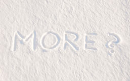 Mais? - escrito na neve Foto de Stock