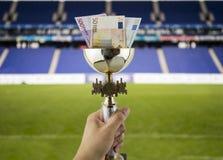 Mais euro mais títulos com o fundo de um estádio Fotografia de Stock Royalty Free