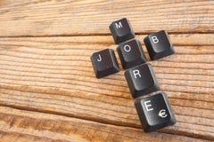 MAIS TRABALHO escreveu com chaves de teclado Fotografia de Stock