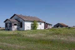 Maison abandonnée de prairie Photographie stock