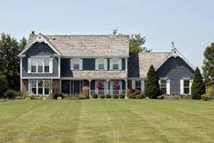 Maison avec le porche avant Image stock