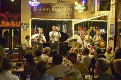 Maison Bourbon Jazz Club with Dixieland band and trumpet player performing at night in French Quarter in New Orleans, Louisiana stock photos