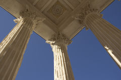 Maison carre nimes. A detail of the roman building in Nimes, France with columns and blue sky Royalty Free Stock Images