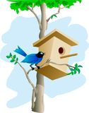 Maison d'oiseau et d'arbre Image stock