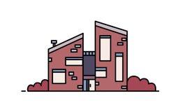 Maison de brique construite dans le style architectural contemporain utilisant des matériaux d'eco Bâtiment moderne de ville d'is Photographie stock