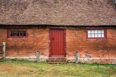 Maison de brique dans la campagne anglaise Photographie stock libre de droits