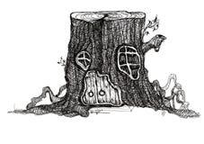 Maison de conte de fées dans un tronçon d'arbre Photographie stock