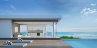 Maison de plage de luxe avec la piscine de vue de mer dans la conception moderne Illustration Libre de Droits