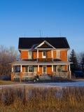 Maison de terres cultivables Images stock